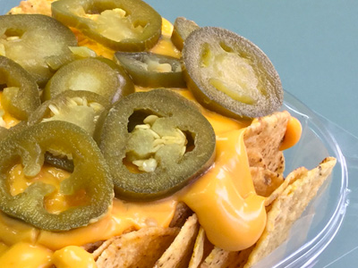 Nachos with melted cheese and jalapenos on top.